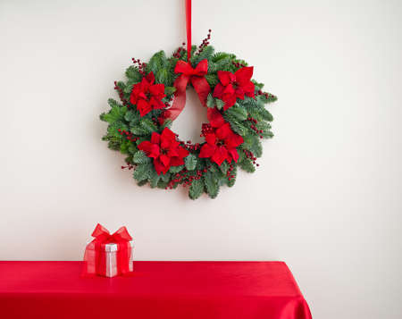Advent wreath over side board with silver color present photo