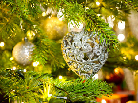 Bauble in a real Christmas tree in bright color  photo