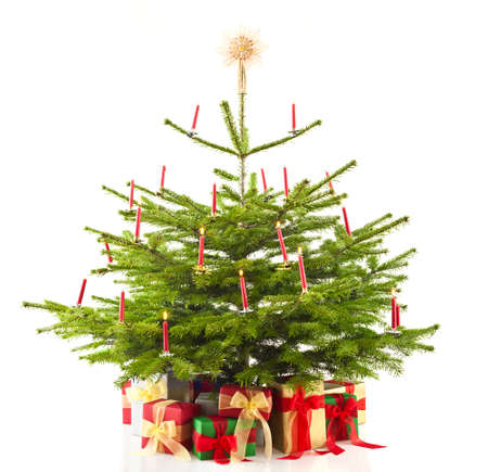 Christmas tree decorated with presents over white photo