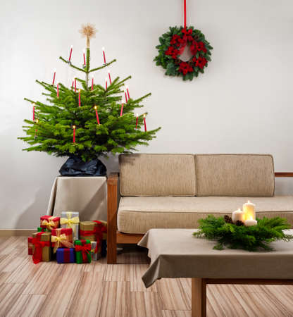 Christmas tree in living room decorated with presents photo