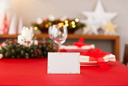 place card: Red Christmas dinner table setup with name place card