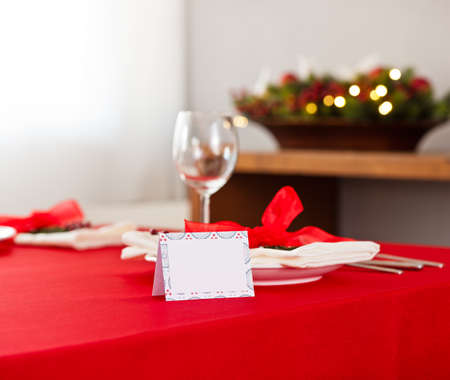 Christmas dinner table setting with name card in red photo