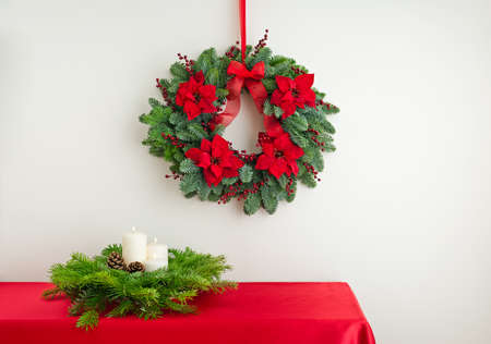Advent wreath over side board with candles in flower arrangement  photo