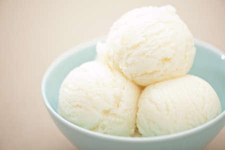Vanilla ice cream over a beige background