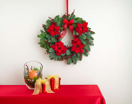 Advent wreath over side board with gifts   photo