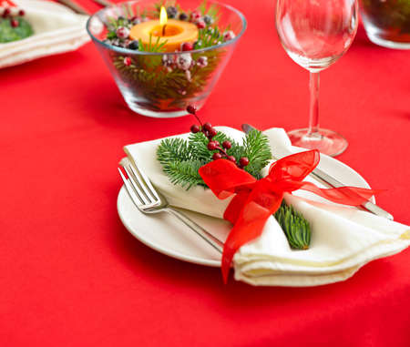 Christmas Dinner table setting with real tree decoration photo