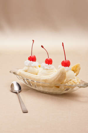 brown banana: Banana Split Ice Cream isolated over color background