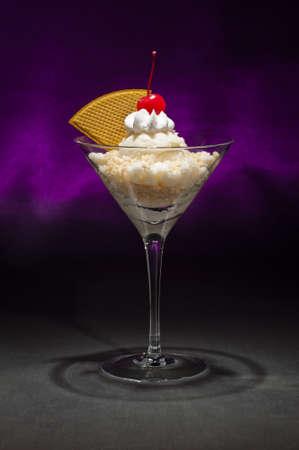 maraschino: Vanilla ice cream in a Martini glass with with waffle decoration Stock Photo