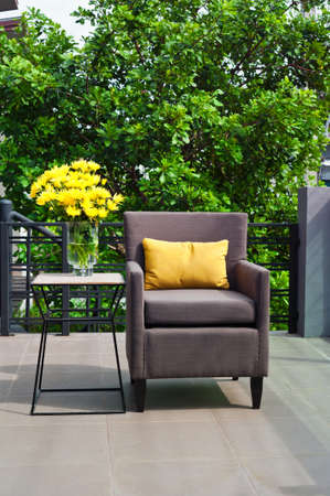 Outdoor patio seating are with nice Rattan sofa at sunset photo
