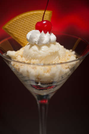 eis: Schwarzwaelder Kirsch ice cream in a Martini glass  with with waffle decoration Stock Photo