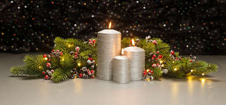 advent wreath: Three Silver Candles with Christmas tree branches and baubles decorated
