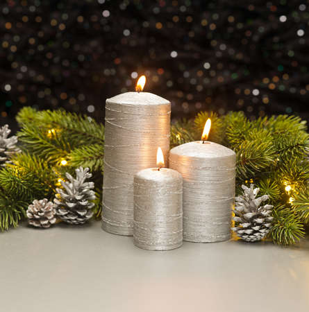 pine three: Three Silver Candles with Christmas tree branches and pine cones decorated