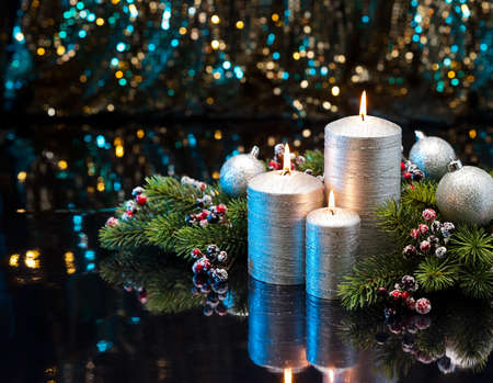 candle light: Three Silver Candles with Christmas tree branches and baubles decorated