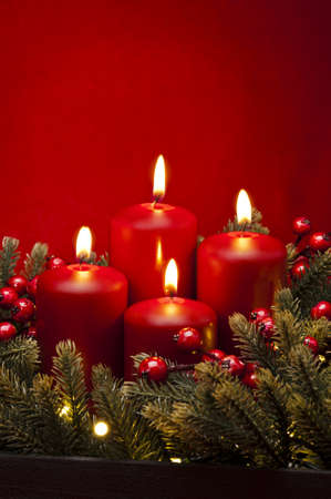 advent wreath: 4th Advent red candle Christmas flower arrangement with berries
