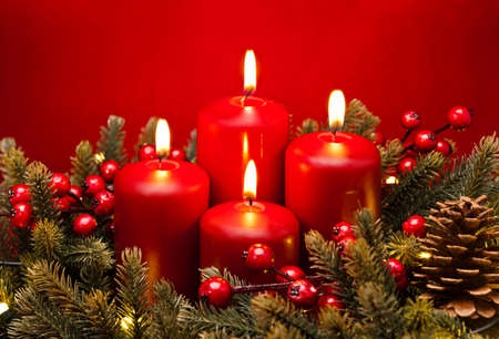 4th Advent red candle Christmas flower arrangement with berries