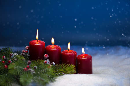 by candle light: 4th Advent candle in snow and snowfall