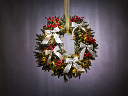 Advent wreath over silver background with gold ribbon photo