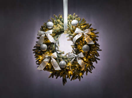 Advent wreath over silver grey background Christmas lights photo