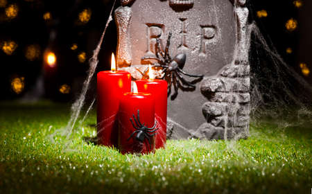 Halloween gravestone over green lawn and under starry sky photo