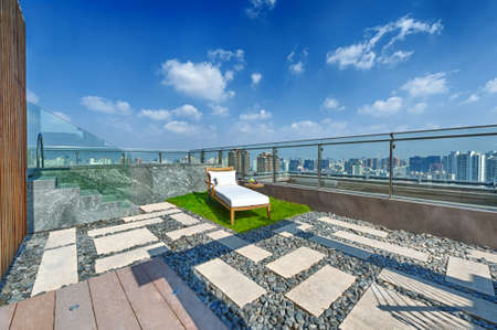 Roof terrace with jacuzzi and sun lounger during day