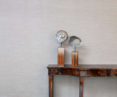 home interior: Sideboard in front of a grey wall with natural gem object