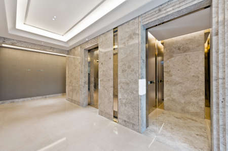 hotel hallway: Lift lobby in beautiful marble without people Stock Photo