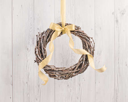 christmas gold: Advents wreath with autumn decoration over a white wooden background