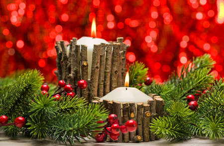 White candles in autumn winter decoration with real branch decoration Reklamní fotografie - 43073314