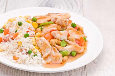 chicken rice: Chicken Cashew Rice dish over bright surface Stock Photo