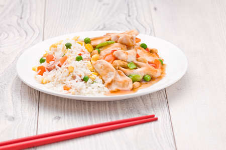 background food: Chicken Cashew Rice dish over bright surface Stock Photo