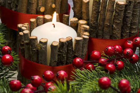 table decoration: White candle in autumn winter decoration with real branch decoration Stock Photo