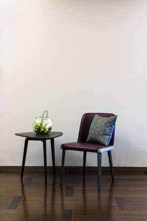 Coffee table Leather chair combination in front of a plain wall