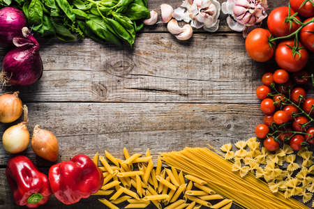 Italian cooking ingredients on a old rustic wooden table Banco de Imagens