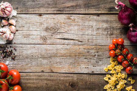 italian: Italian cooking ingredients on a old rustic wooden table Stock Photo