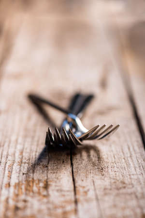grunge cutlery: Forks on a old wooden table close up shot Stock Photo