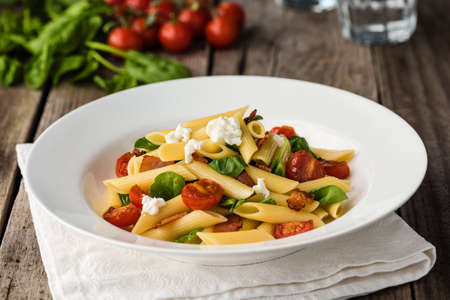 spaghetti: Tomato and Bacon Penne Pasta on wood table