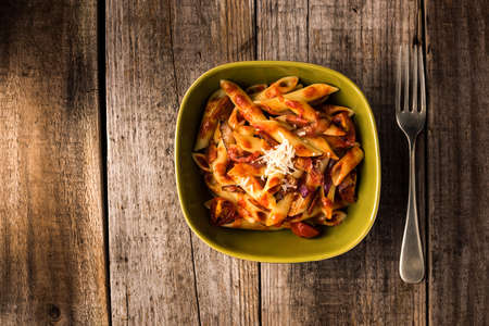pasta sauce: Penne Pasta with Chorizo Creamy Tomato Sauce on Rustic Table Top