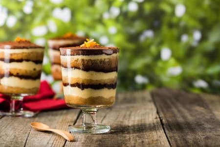 fine dining: Tiramisu dessert on a wooden rustic table