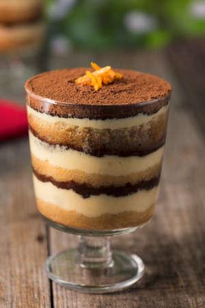 layer: Tiramisu dessert on a wooden rustic table
