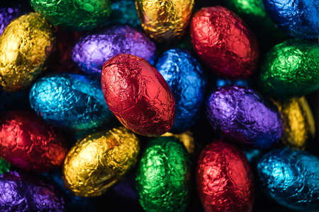 green and purple: Red, green, purple and blue easter eggs a close up Stock Photo