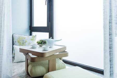 copy room: Prepared tea ceremony in a window niche bright lighted