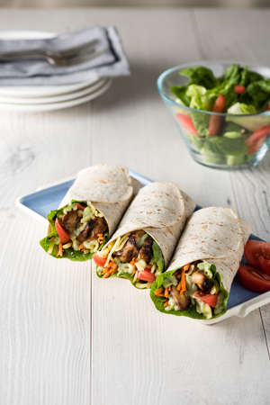 baby spinach: Grilled chicken with fresh vegetable burrito wraps Stock Photo