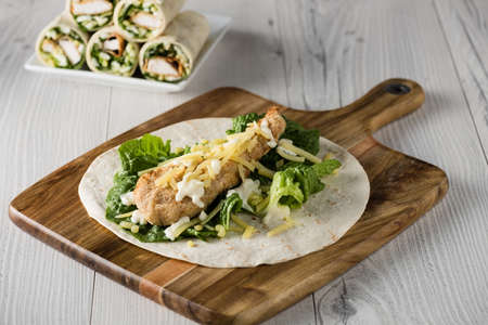 tortilla wrap: Crumbed Chicken Tortilla Wrap With Fresh Lettuce Cheese