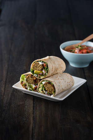 falafel: Vegetarian falafel wraps with avocado and cheese