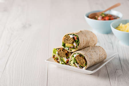baby spinach: Vegetarian falafel wraps with avocado and cheese