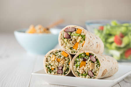 baby spinach: Vegan quinoa wraps with chickpea, kidney beans and pumpkin
