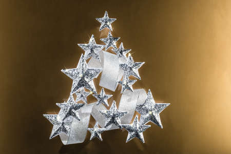 silver ribbon: Silver sparkling Stars and Silver Ribbon over plain background Stock Photo