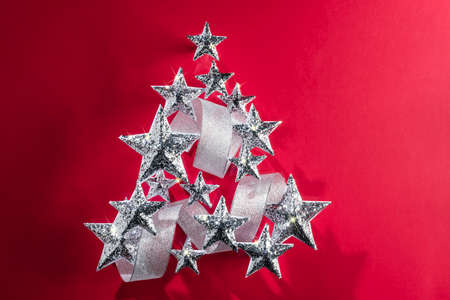 silver background: Silver sparkling Stars and Silver Ribbon over plain background Stock Photo