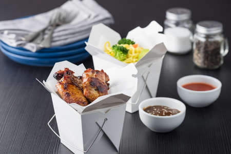 takeout: Asian chicken wings and noodles in take-out box