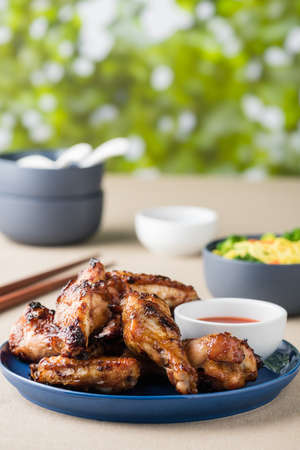 Barbecue chicken wings serves noodles with hot dipping sauce